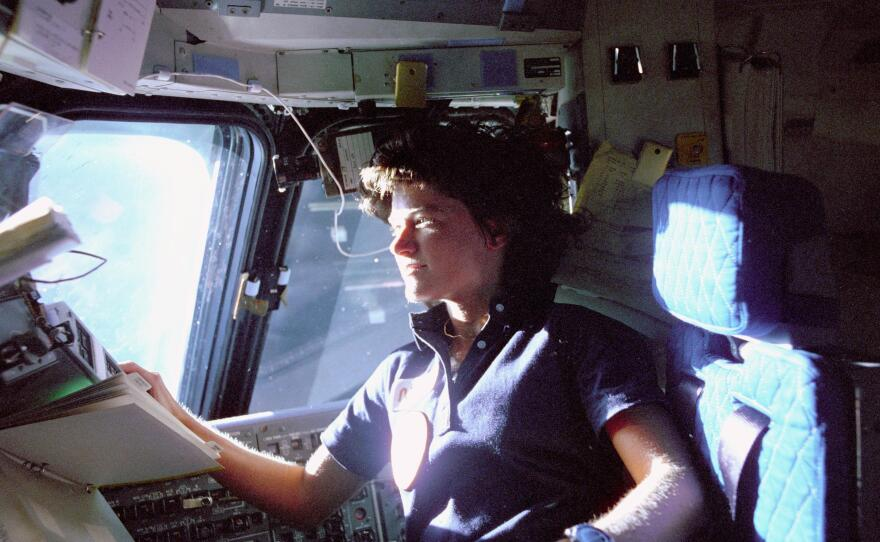 Sally Ride in the pilot chair of the space shuttle after launching into history as America's first female astronaut, June 18, 1983.