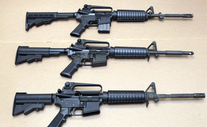 Three variations of the AR-15 rifle are displayed at the California Department of Justice in Sacramento, Calif., in a 2012 photo.