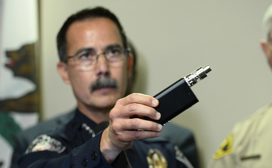 El Cajon Police Capt. Jeff Davis holds a vaping device similar to the one that police say Alfred Olango was holding, October 1, 2016.