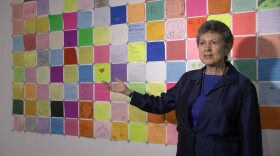 Curator Lillian Faderman stands next to the community quilt at the San Diego History Center on July 12, 2018.