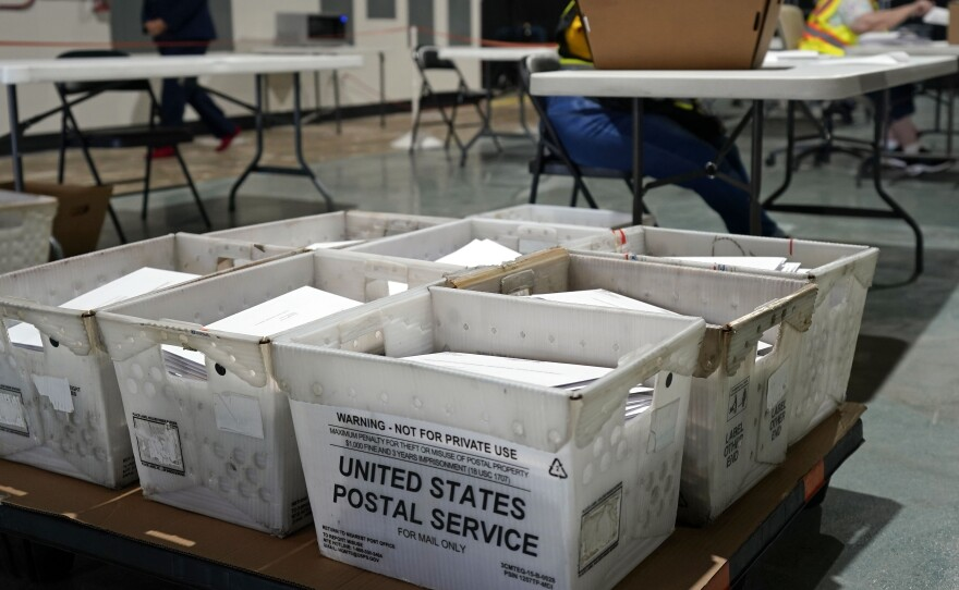 Workers prepare absentee ballots for mailing at the Wake County Board of Elections in Raleigh, N.C., Thursday, Sept. 3, 2020. Other states will soon follow North Carolina in sending out ballots to voters as a nearly two month-long general election voting season gets underway.