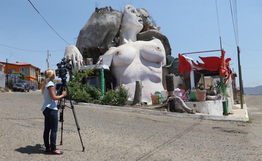 KPBS videographer Katie Euphrat capturing La Sirena (the mermaid), a house south of Rosarito, Mexico. It was built by Armando Muñoz García>
