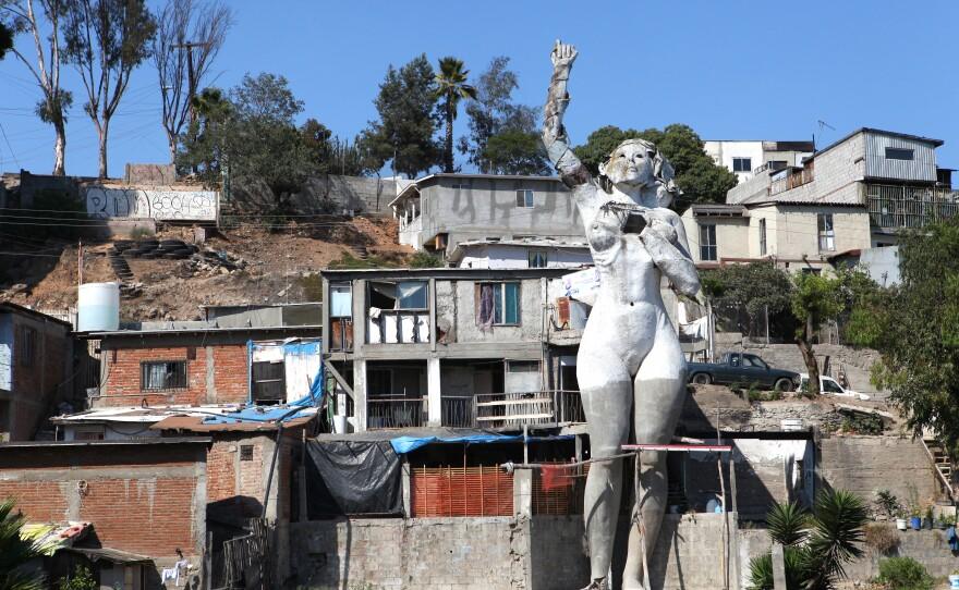 "Muñoz also built ""La Mona,"" which has become a Tijuana icon. She's sometimes referred to as Tijuana's Statue of Liberty."