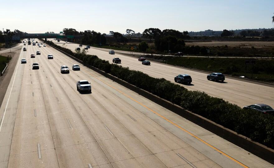 Traffic on Interstate 5 freeway at Sea World Drive on Nov. 24, 2020.
