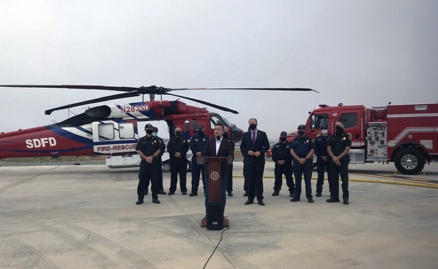 Councilmember Chris Cate, Mayor Kevin Faulconer and San Diego Fire Chief Colin Stowell at a press conference to stress the importance of fire preparedness as the peak fire season begins.