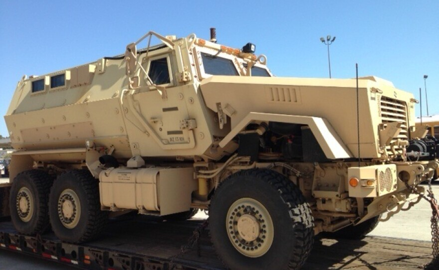 An image shows the MRAP was painted tan when it was first received by the San Diego Unified School District.