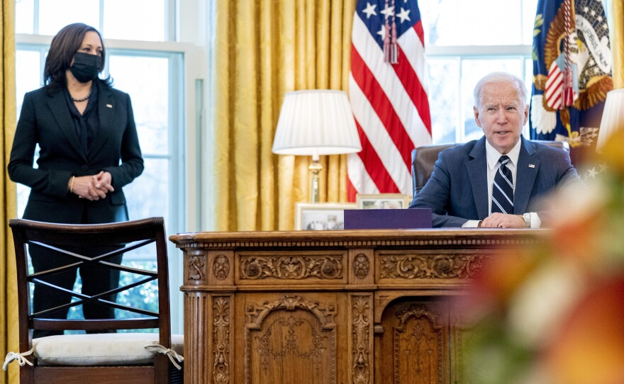 President Joe Biden, accompanied by Vice President Kamala Harris, speaks before signing the American Rescue Plan, a coronavirus relief package, in the Oval Office of the White House, Thursday, March 11, 2021, in Washington.