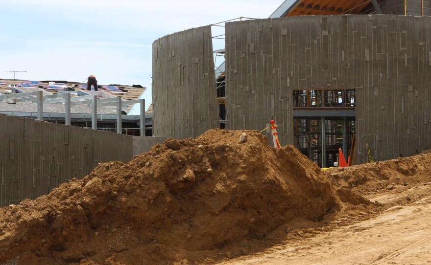 A mound of earth sits in front of the under-construction rotunda that will serve as the entrance to Ocean Discovery Institute's upcoming Living Lab in San Diego's City Heights neighborhood, April 24, 2017.