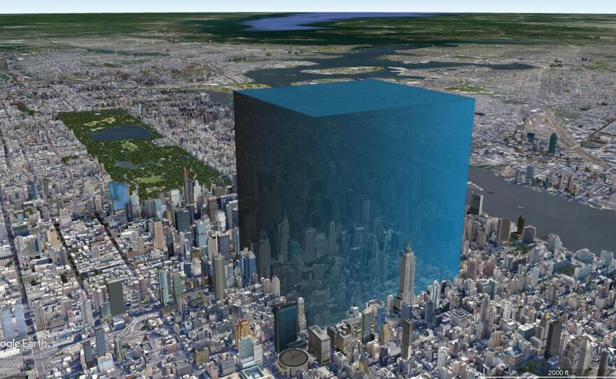 The amount of water that escaped the lake, superimposed on the skyline of New York City.