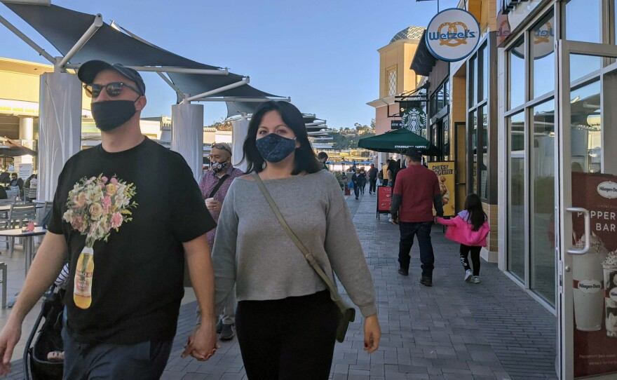 Shoppers wearing masks at the Fashion Valley Mall food court in this file photo from Nov. 28, 2020.