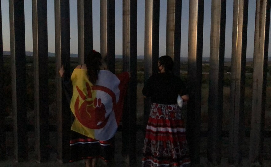 Kumeyaay protesters stand next to newly-built border wall in the Laguna Mountains on July 17, 2020.