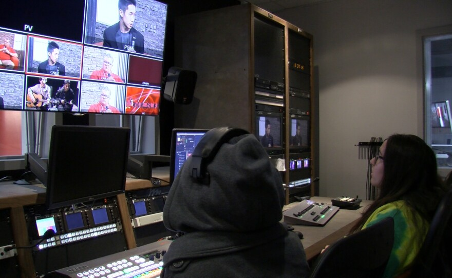 Students at Hoover High School monitor an on-set interview from the control room, Jan. 23, 2017.