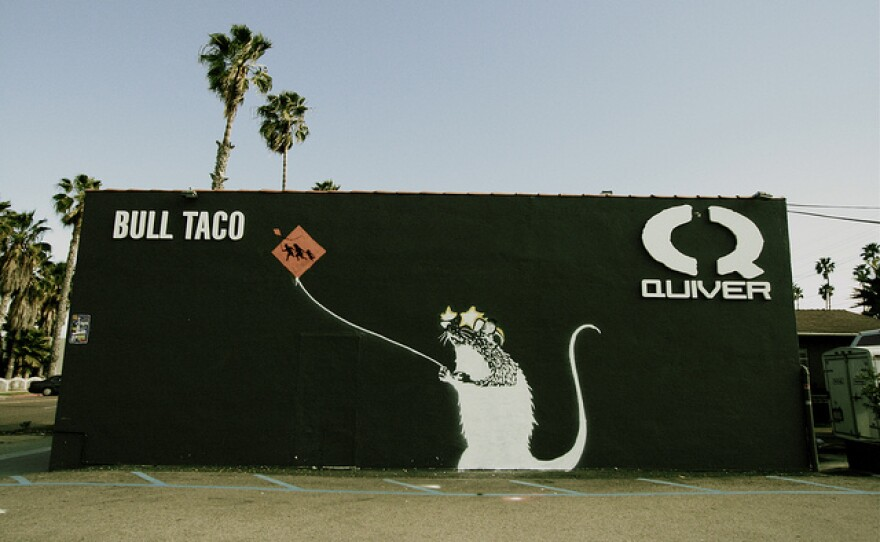 The mural that has been rumored to be by the street artist Banksy is officially not by the secretive street artist. Photo by Flickr user Tasha Parker.