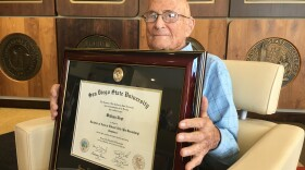 Bill Vogt, the last remaining San Diego State University student known to have attended classes at the old campus in University Heights, shows off his graduate diploma, Aug. 16, 2018.