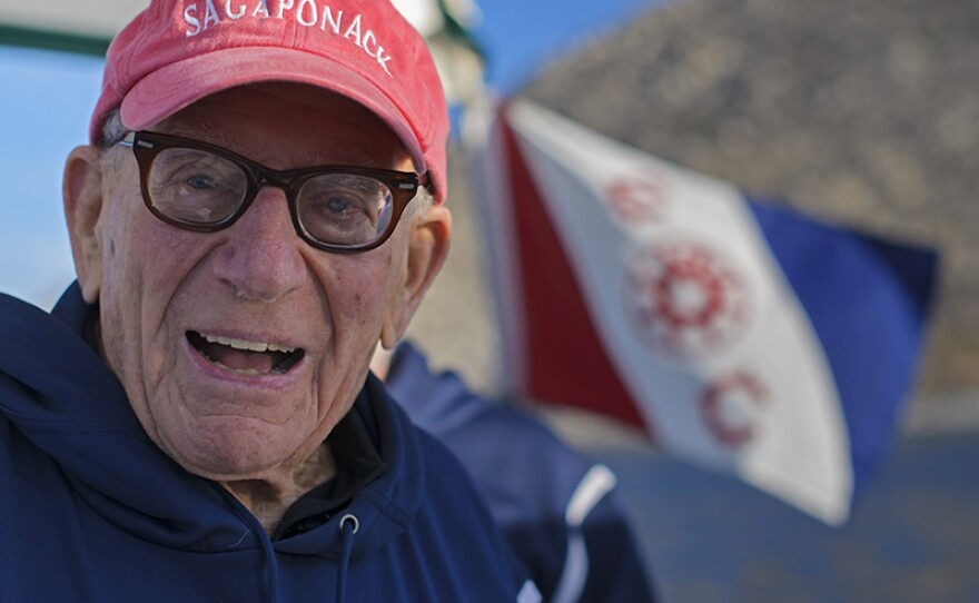 Walter Munk in Cabo Pulmo National Marine Park with Explorers Club flag in background, east coast of Mexico's Baja California Peninsula.