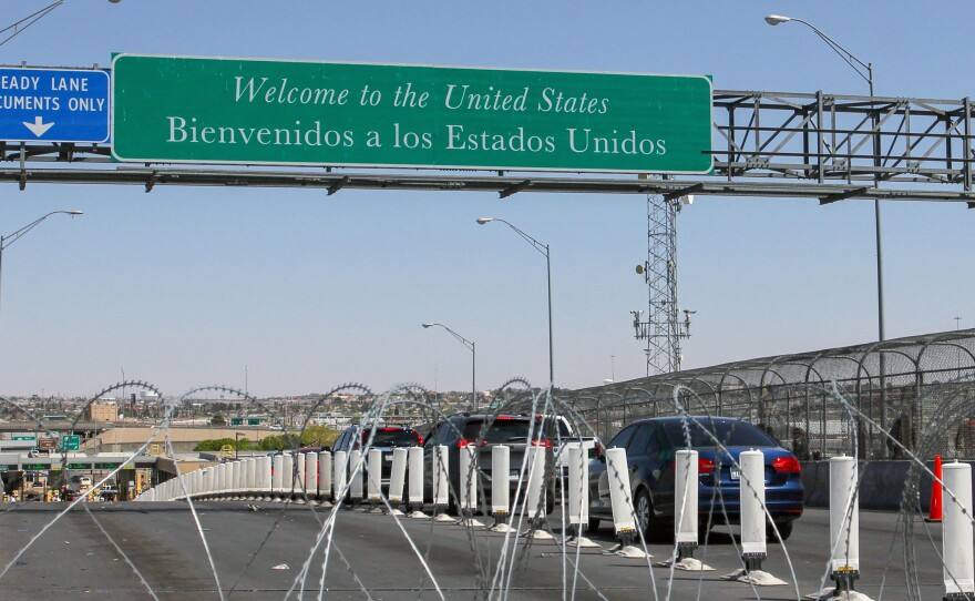 Drivers line up in the border city of Juárez in Mexico's Chihuahua state, as they attempt to cross the border at El Paso, Texas. The Guatemalan consul has confirmed that a Guatemalan boy apprehended with his mother last month had died Tuesday night.