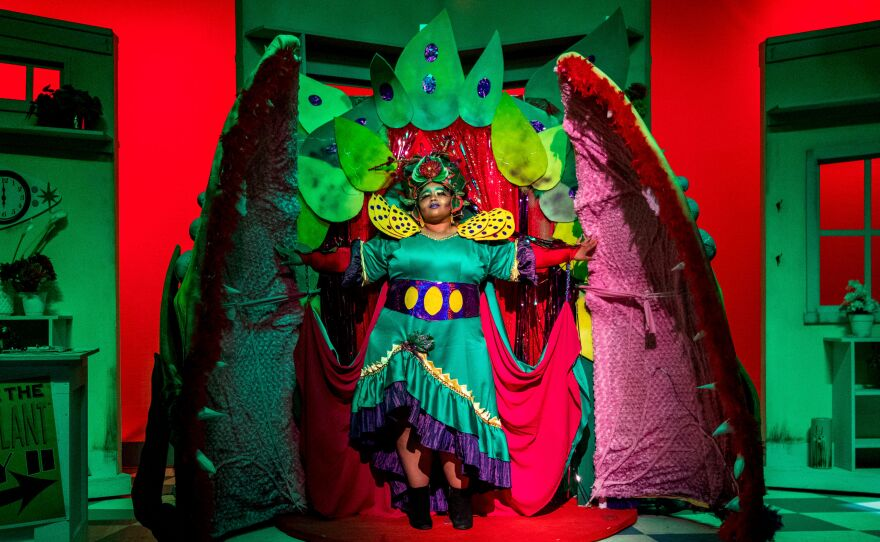 """Eboni Muse brings Audrey II to life in New Village Arts Theatre's production of """"Little Shop of Horrors,"""" playing through Aug. 4."""