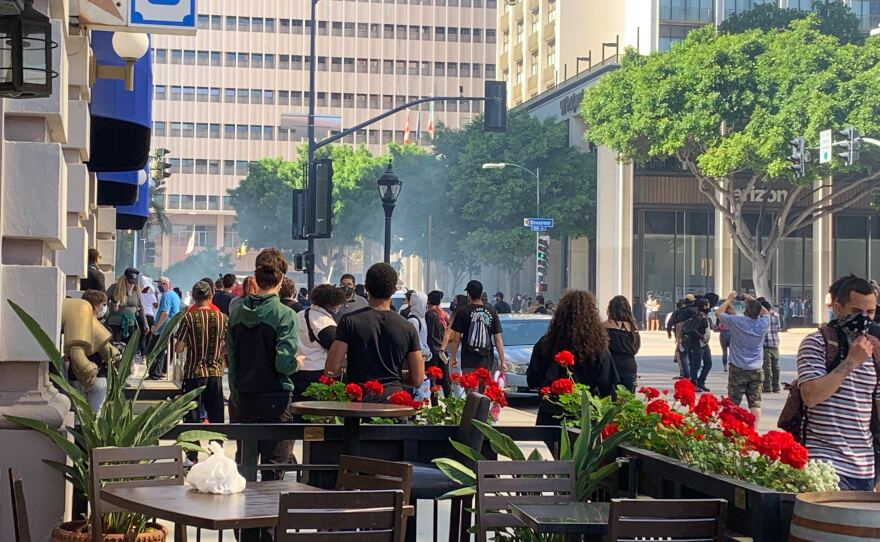 Police fire tear gas into a crowd of demonstrators in downtown San Diego, May 31, 2020.