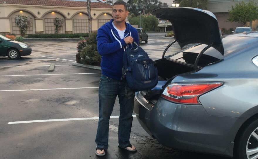 After finishing his first Uber/Lyft driving shift, Chad Bordes heads to the gym to shower and change before starting his next job selling cars online, March 15, 2018.