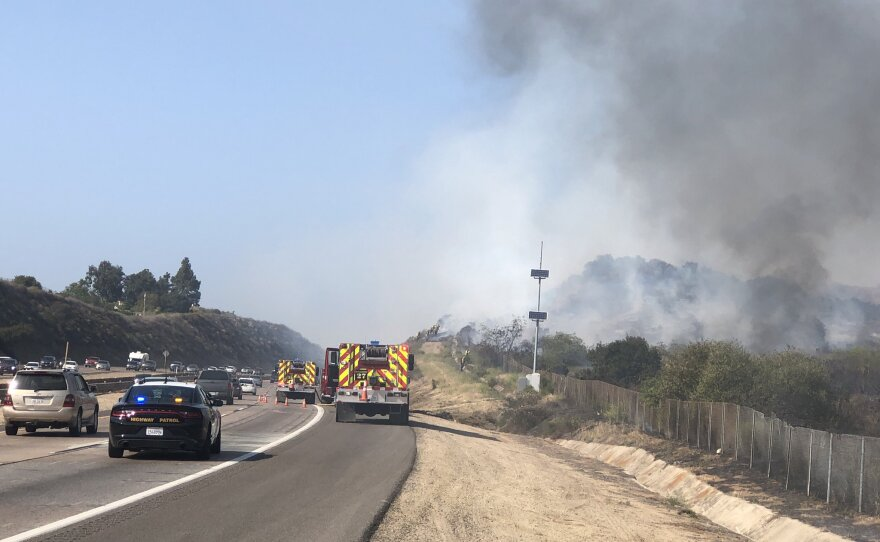 Smoke from the Coches Fire seen on Interstate 8 in Lakeside, May 12, 2021.