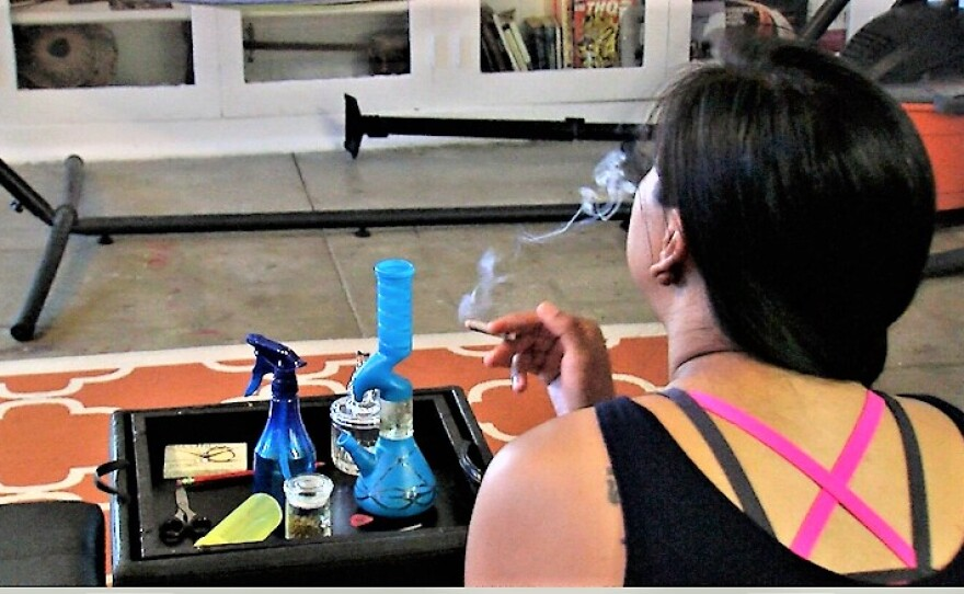 A San Diego woman, who does not want to be identified because she smokes marijuana daily in her San Diego apartment, says she is a better driver when she is stone, May 18, 2017.