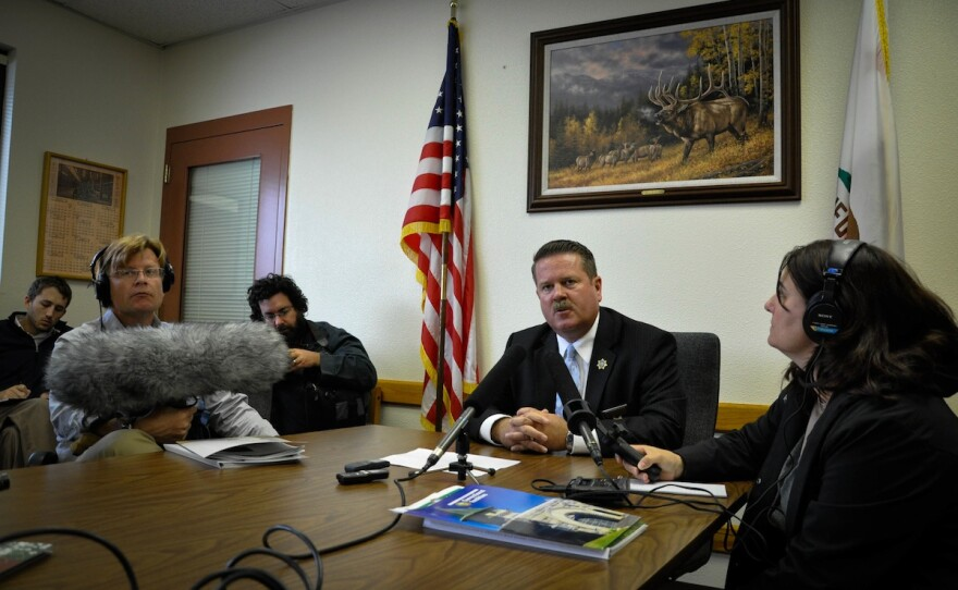 Acting Warden Greg Lewis fields reporters' questions about Pelican Bay State Prison's policies of indefinitely confining validated gang members in isolation units.