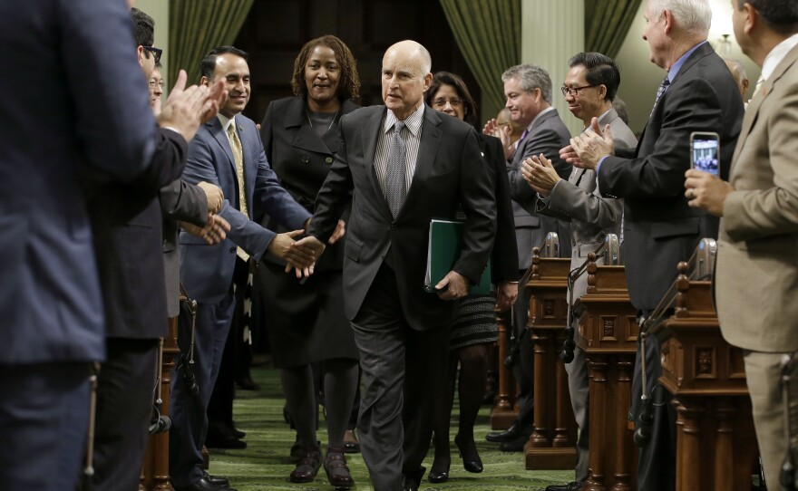 Calif., Gov. Jerry Brown is greeted by lawmakers as he enters the Assembly to deliver his annual State of the State address to a joint session of the state Legislature Tuesday, Jan. 24, 2017, in Sacramento, Calif.