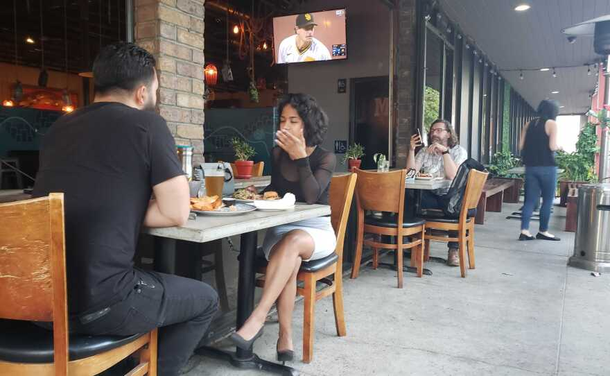 Patrons dining outside at Common Theory in the Kearny Mesa neighborhood of San Diego, Calif. August 5, 2020.