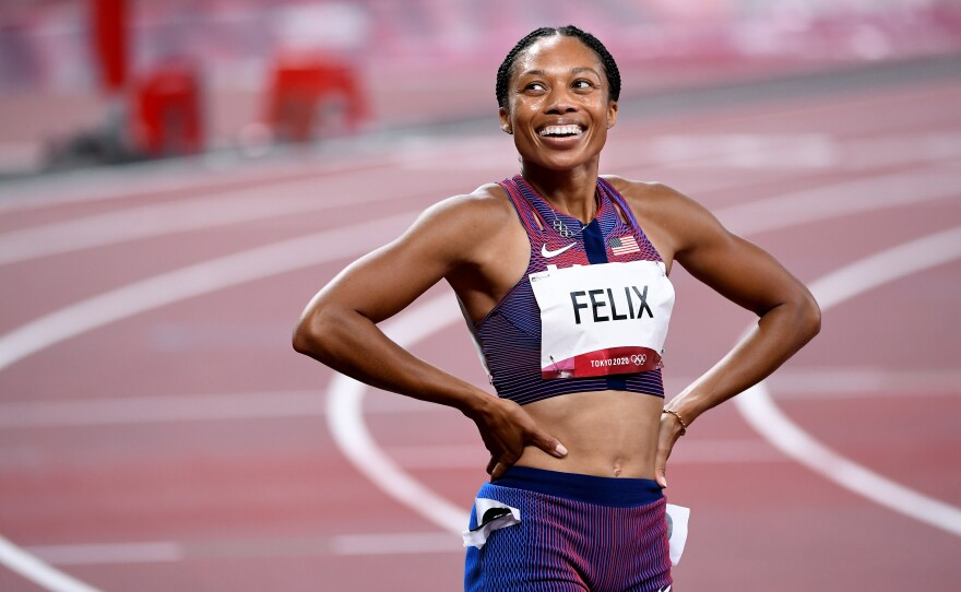 U.S. track star Allyson Felix smiles after winning the bronze medal in the 400 meter race on Friday.
