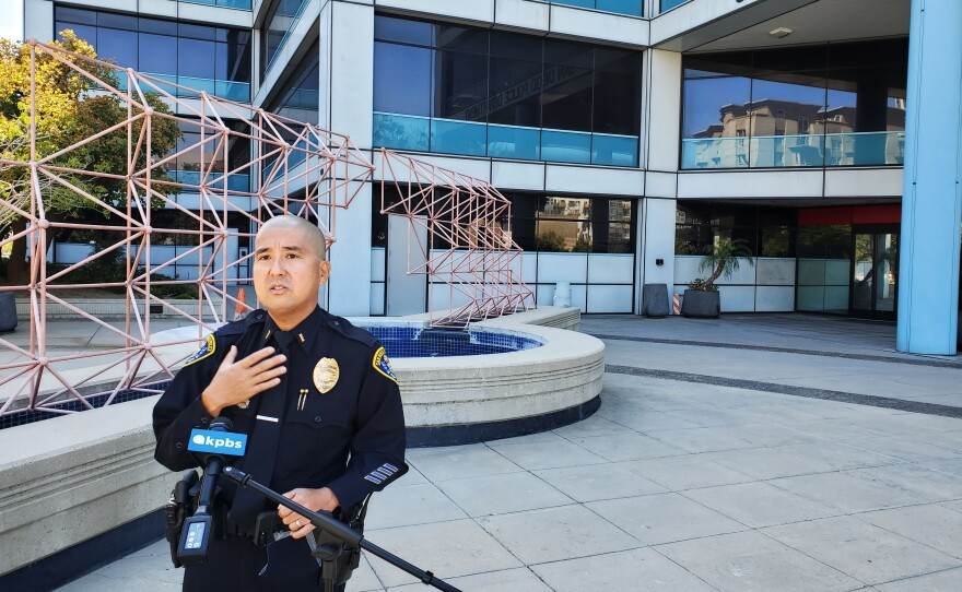 San Diego Police spokesman Lt. Shawn Takeuchi talks outside police headquarters, Aug. 10, 2020.