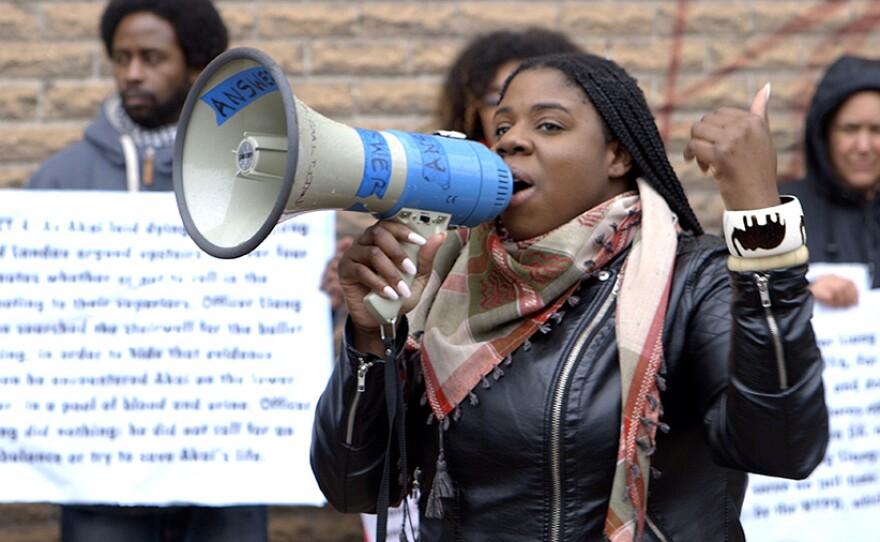 Film subject Kerbie Joseph speaks in support of Akai Gurley near the Euclid Avenue A-train subway stop in Brooklyn, N.Y.