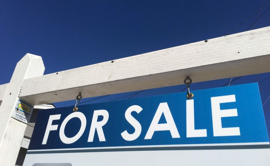 """A """"For Sale"""" sign in front of a home in San Carlos in this undated photo."""