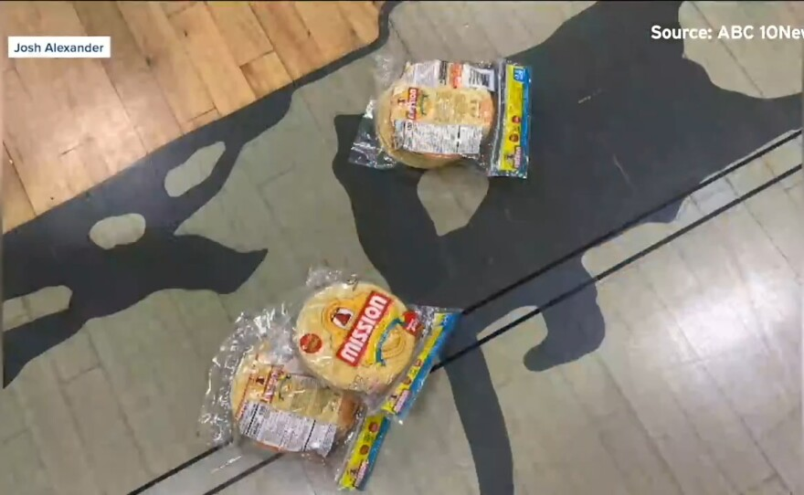 Tortillas are shown on the floor of the basketball court at Coronado High School following a game on June 19, 2021.