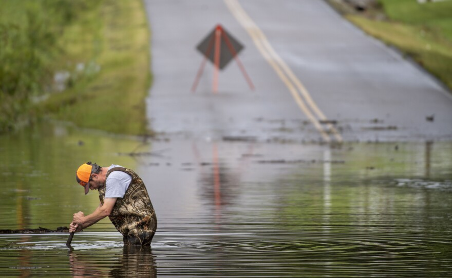Dickson Public Works personnel check the flooding on Old Pond Lane following heavy rainfall on Saturday in Dickson, Tenn.