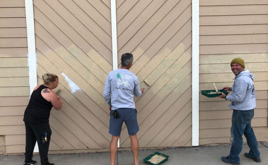 Employees at La Mesa Lumber and Hardware repainted the morning after protests at the police department and city hall down the street turned violent and businesses were vandalized with graffiti, May 31, 2020.