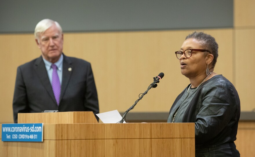 Public Health Officer Dr. Wilma Wooten speaks at a San Diego County news conference with Board of Supervisors Chairman Greg Cox, March 19, 2020.