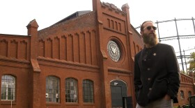 """Stone Brewing's co-founder Greg Koch at the 19th century gasworks that was to be transformed into the first American craft brewery in Germany in the documentary """"The Beer Jesus From America."""""""