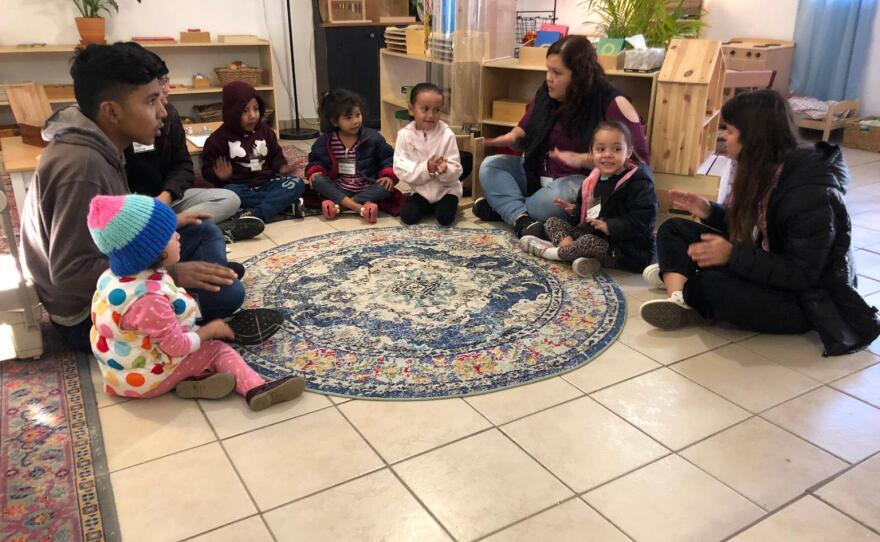 """Children and volunteers sing together at """"The Nest"""" in Tijuana on January 27, 2020."""