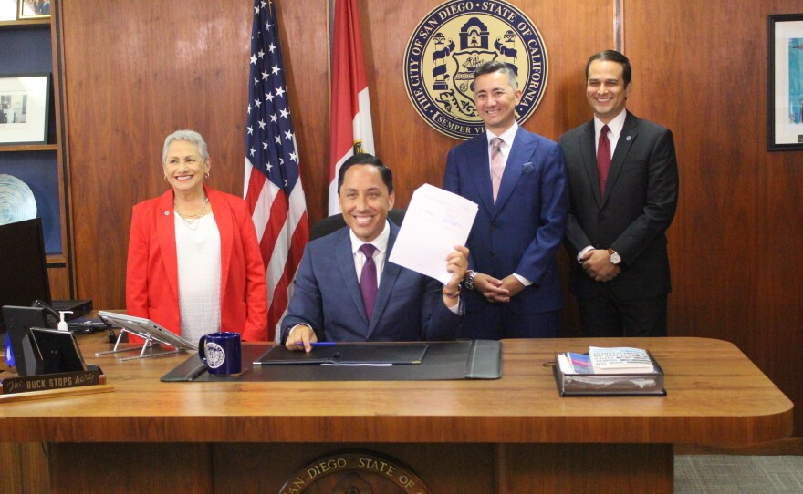 Todd Gloria signs the San Diego city budget in his office, San Diego, Calif. June 21, 2021.