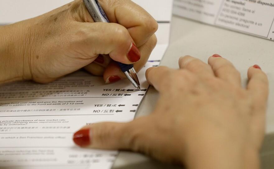 A woman fills out a ballot in California, June 7, 2016.