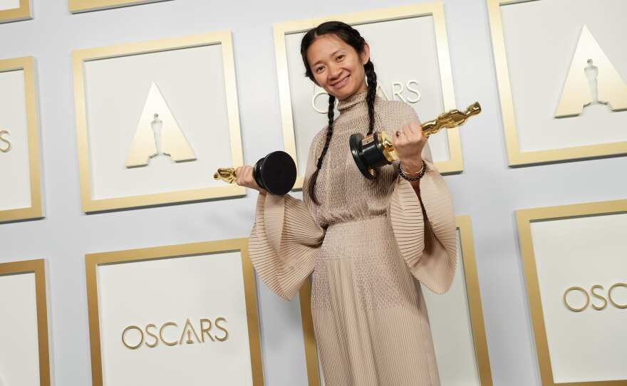 """Chloe Zhao made Oscar history by becoming the first woman of color to win a best director Oscar. She also took home a second for producing her film """"Nomadland."""""""