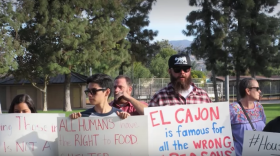 Demonstrators protest El Cajon's city ordinance banning people from feeding the homeless in public spaces, Nov. 24, 2017.