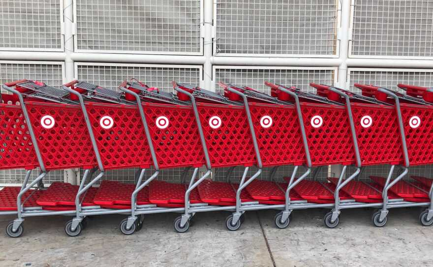 A line of grocery carts are shown parked in front of a San Diego Target store Monday, Dec. 14, 2020.