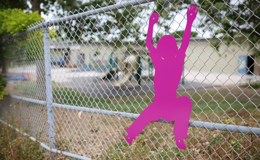 Green Elementary, pictured in the background, has been the subject of several sexual assault claims, May 5, 2016.