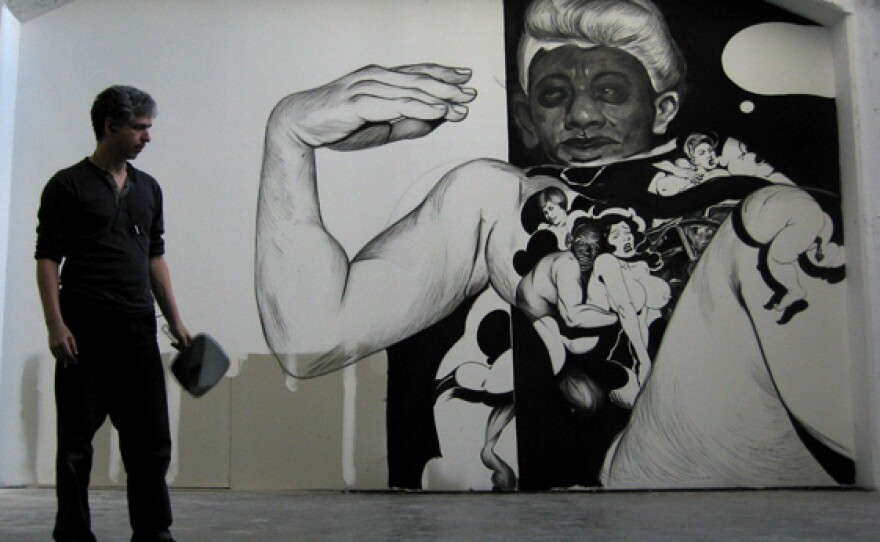 Hugo Crosthwaite at Boffo Projects in New York, in front of one of his wall drawings. The wall drawing shown here is in progress.