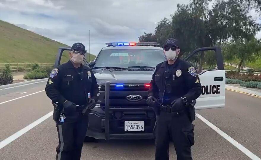 Chula Vista police officers Victor Del Rio and Javier Castillo talk on a department video, April 9, 2020.