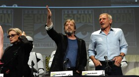 """Carrie Fisher, left, Mark Hamill and Harrison Ford attend Lucasfilm's """"Star Wars: The Force Awakens"""" panel on the second day of Comic-Con International at the San Diego Convention Center, July 10, 2015."""