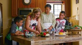 Host Su-Mei Yu (third from left) cooks a delicious meal with a refugee family who now calls El Cajon, Calif. home.