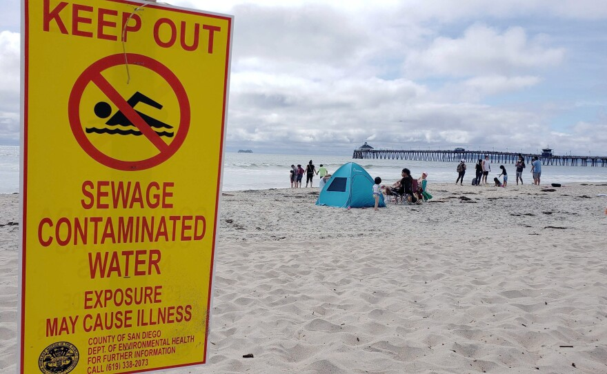 A sign in Imperial Beach on June 28, 2020, warning swimmers of sewage-contaminated water.