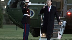 President Donald Trump salutes as he disembarks Marine One upon arrival at the White House in Washington, Sunday, March 5, 2017.